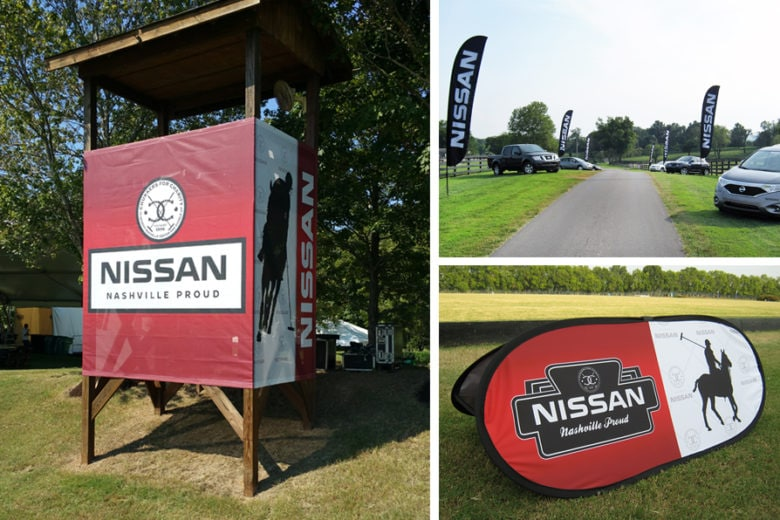 Mesh banners and feather flags for Nissan's Chukkers for Charity event by 12-Point SignWorks in Franklin, TN.