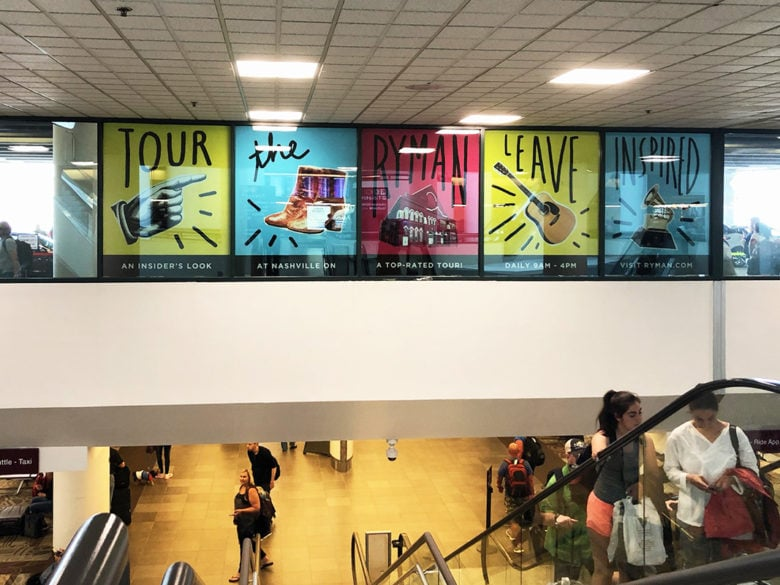 Window graphics installed for Clear Channel Airports at the Nashville International Airport by 12-Point SignWorks.