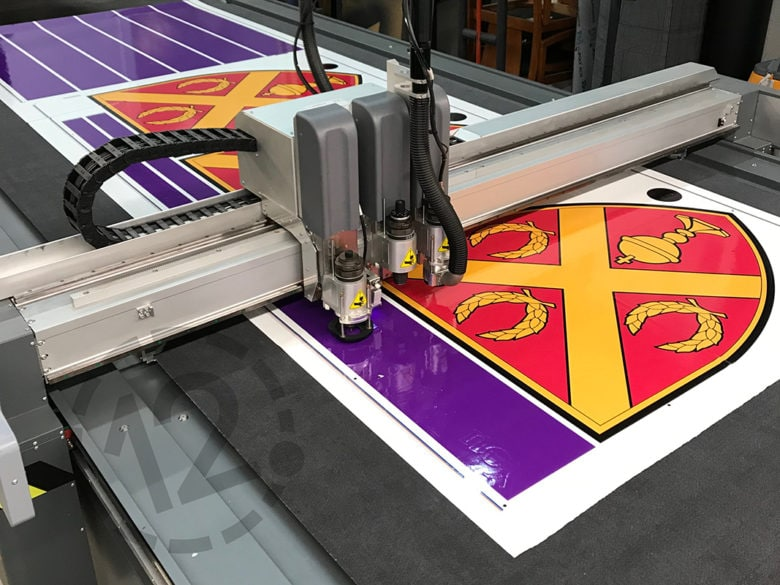 Digital flatbed cutter in action at 12-Point SignWorks in Franklin, TN.