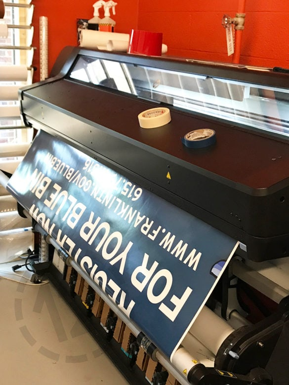 Printing a vehicle wrap for the City of Franklin's Sanitation and Environmental Services Department by 12-Point SignWorks in Franklin, TN.