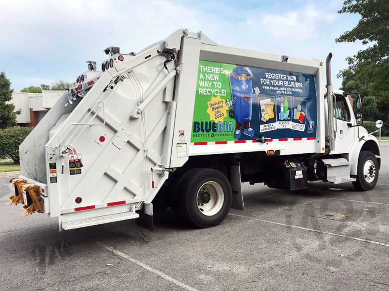 Custom truck wrap to promote the City of Franklin's Blue Bin Recycling Program printed and installed by 12-Point SignWorks in Franklin, TN.
