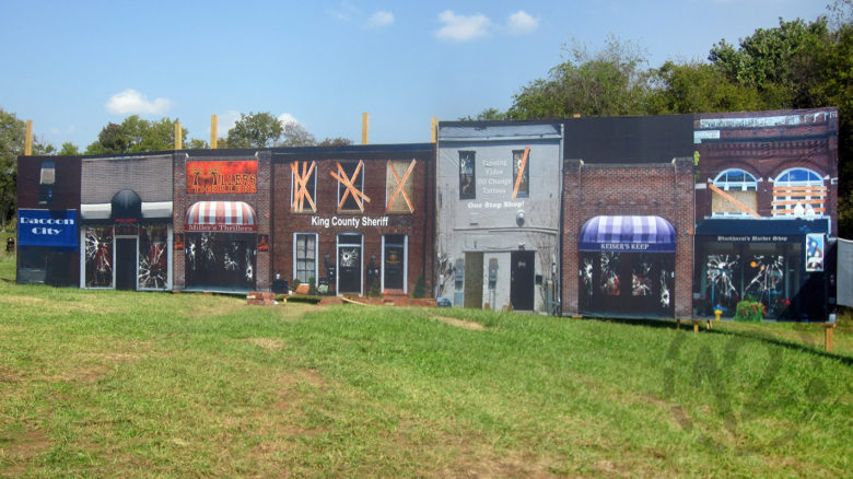 Mesh banner city backdrop for Millers Thrillers Zombie Paintball Hayride printed by 12-Point SignWorks in Franklin, TN.