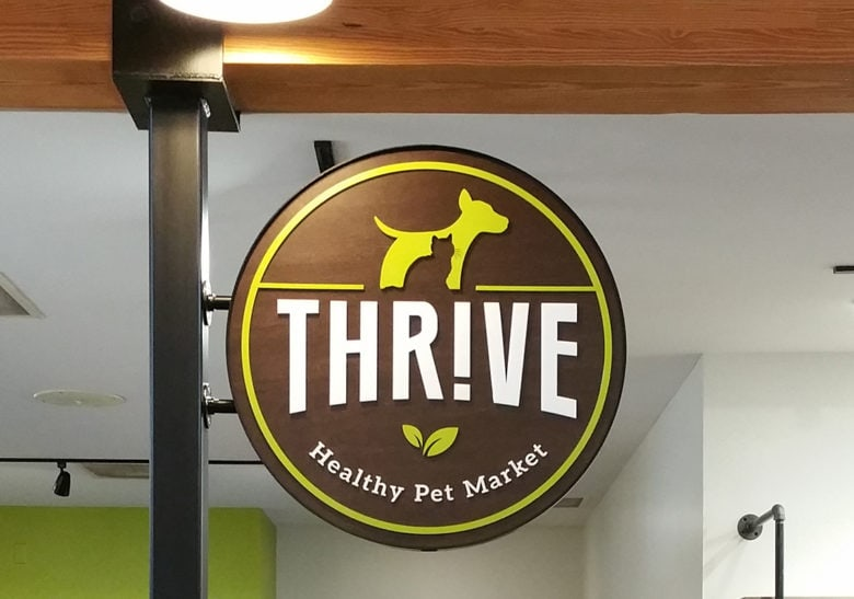 Custom logo sign for Thrive Healthy Pet Market fabricated and installed by 12-Point SignWorks in Franklin, TN.