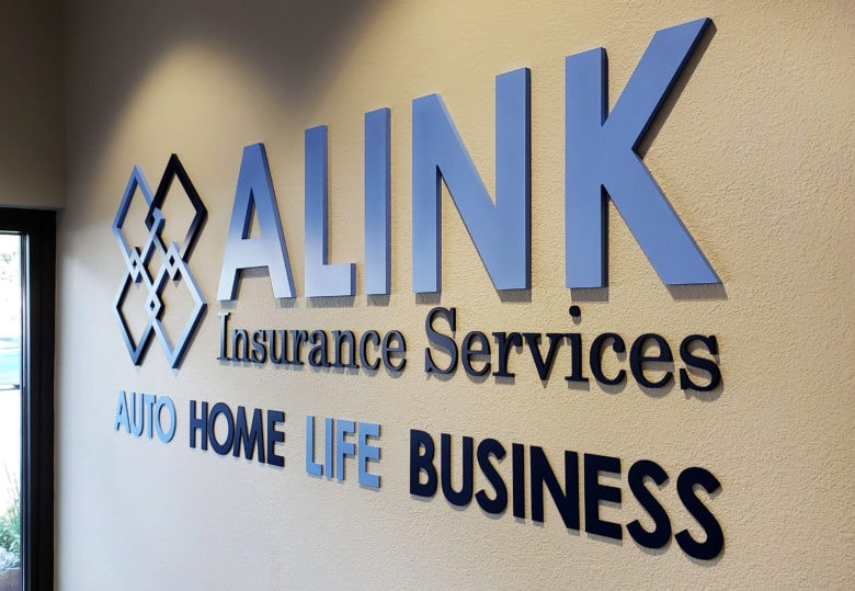 Dimensional acrylic logo sign for ALINK Insurance Services by 12-Point SignWorks.