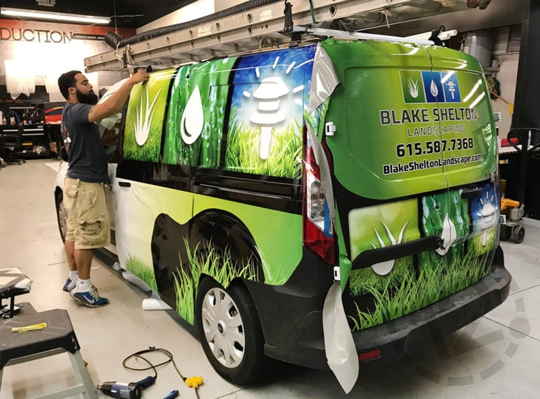 Installation of a custom advertising wrap for Blake Shelton Landscaping by 12-Point SignWorks in Franklin, TN.