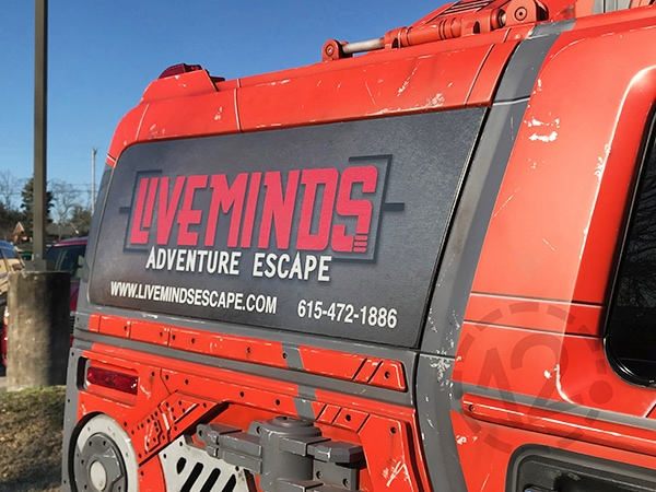 Perforated window vinyl for Liveminds Adventure Escape by 12-Point SignWorks in Franklin, TN.