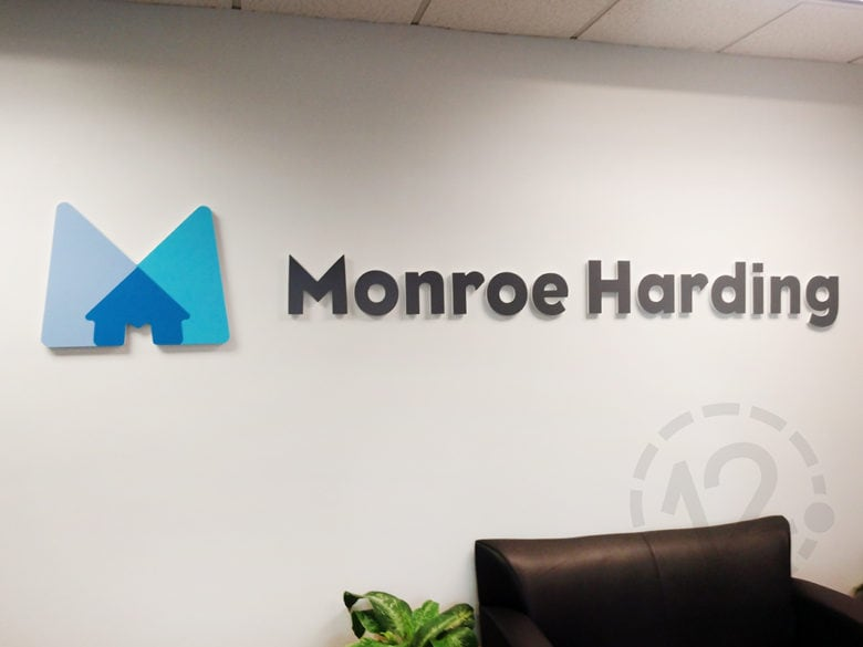 Custom interior office sign for Monroe Harding in Nashville by 12-Point SignWorks.