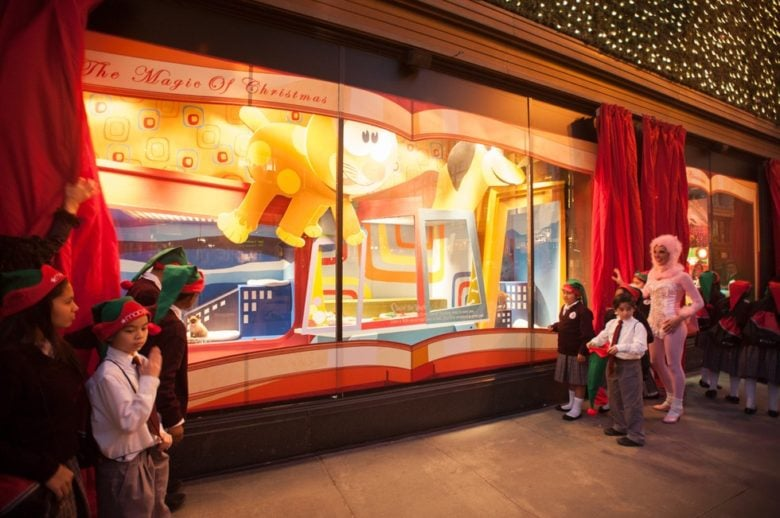 Christmas Window Display featuring live puppies and kittens available for adoption in San Francisco.