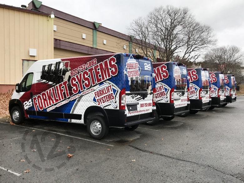 Custom fleet wraps for Forklift Systems in Nashville by 12-Point SignWorks.