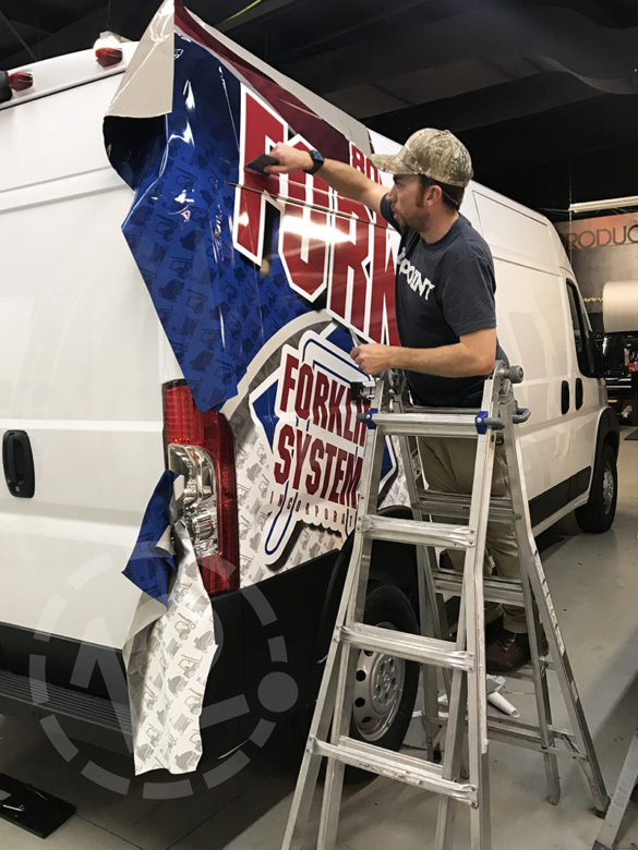 Van wrap installation for Forklift Systems by 12-Point SignWorks in Franklin, TN.