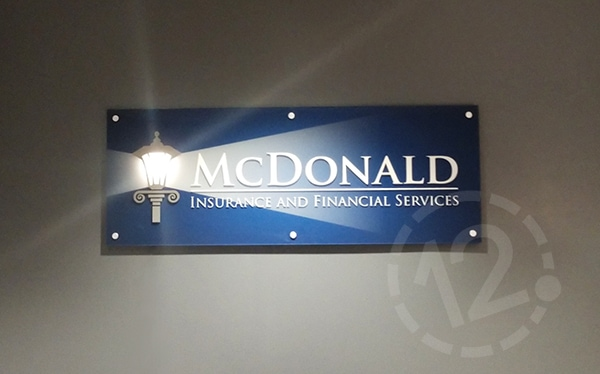 Custom logo sign for McDonald Insurance and Financial Services by 12-Point SignWorks in Franklin, TN.