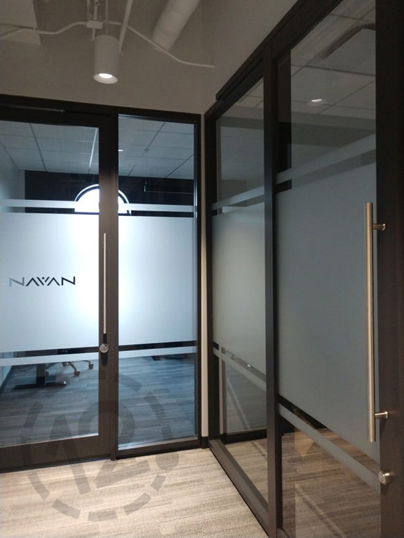 Custom etched window film for E|SPACES in Franklin, TN by 12-Point SignWorks.