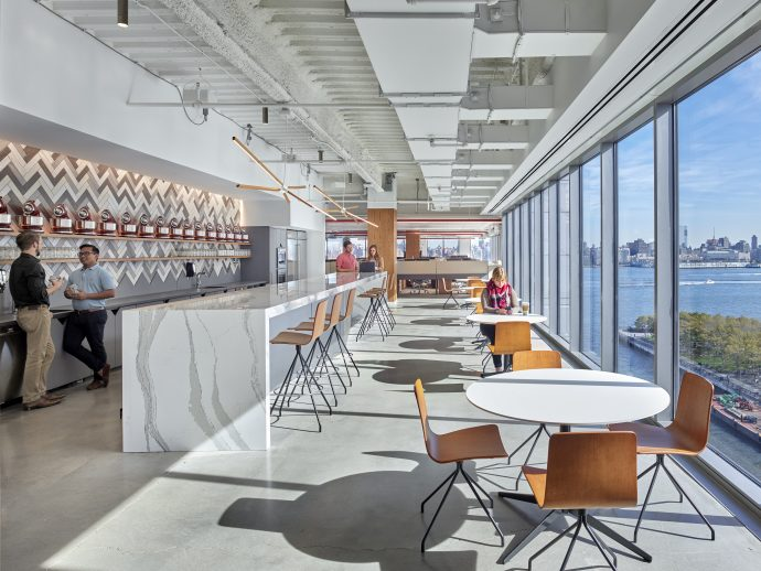 Break room with natural lighting and a beautiful view