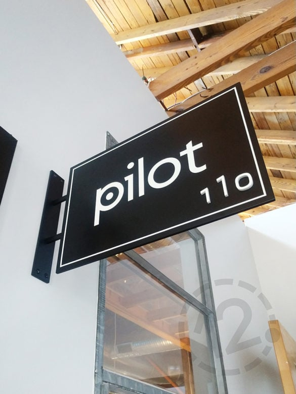 Custom suite ID sign for Pilot at the Sawtooth building in Nashville, TN by 12-Point SignWorks.