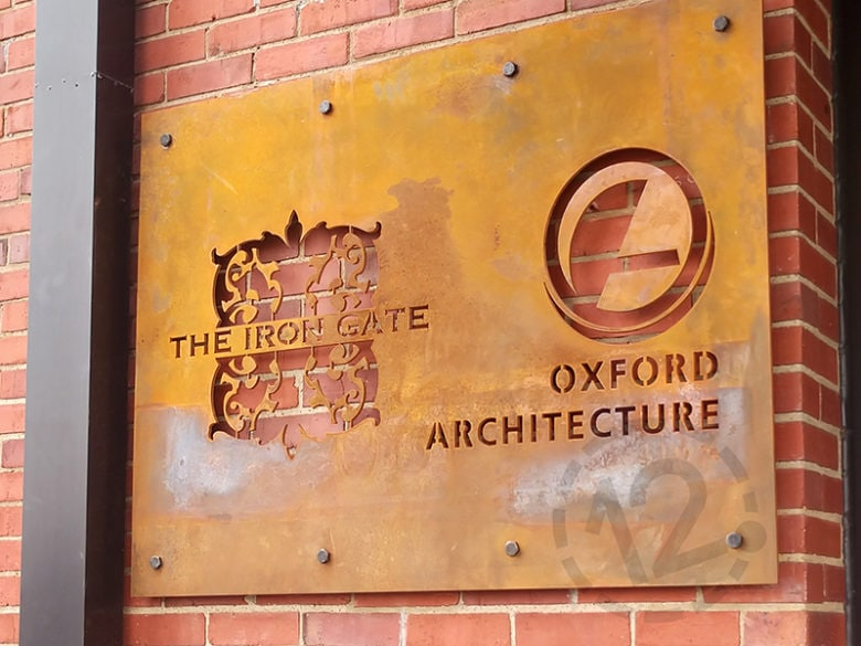 Rustic metal sign for Iron Gate and Oxford Architecture in Nashville, TN by 12-Point SignWorks.