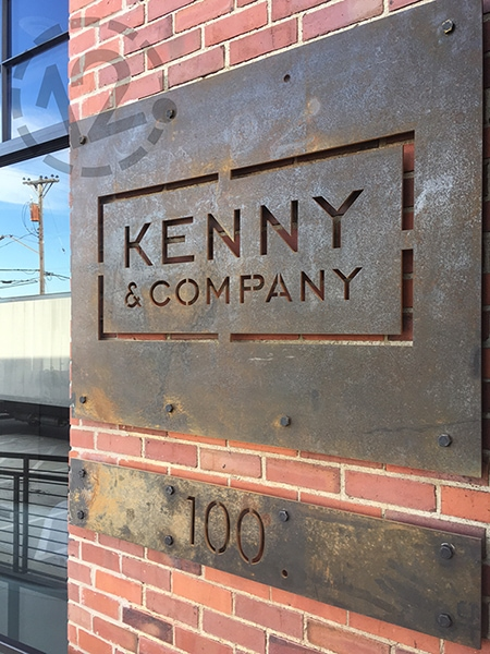 Custom Corten Steel sign for Kenny & Company in Nashville, TN by 12-Point SignWorks.