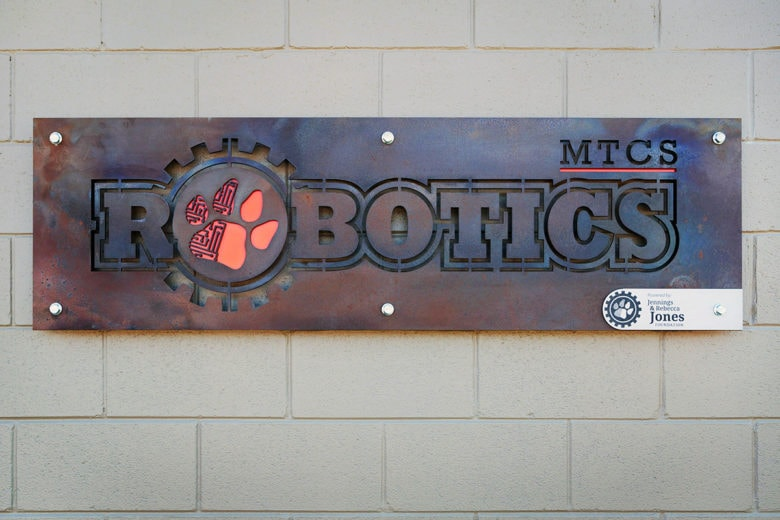 Rustic metal sign for Middle Tennessee Christian School in Murfreesboro, TN by 12-Point SignWorks.