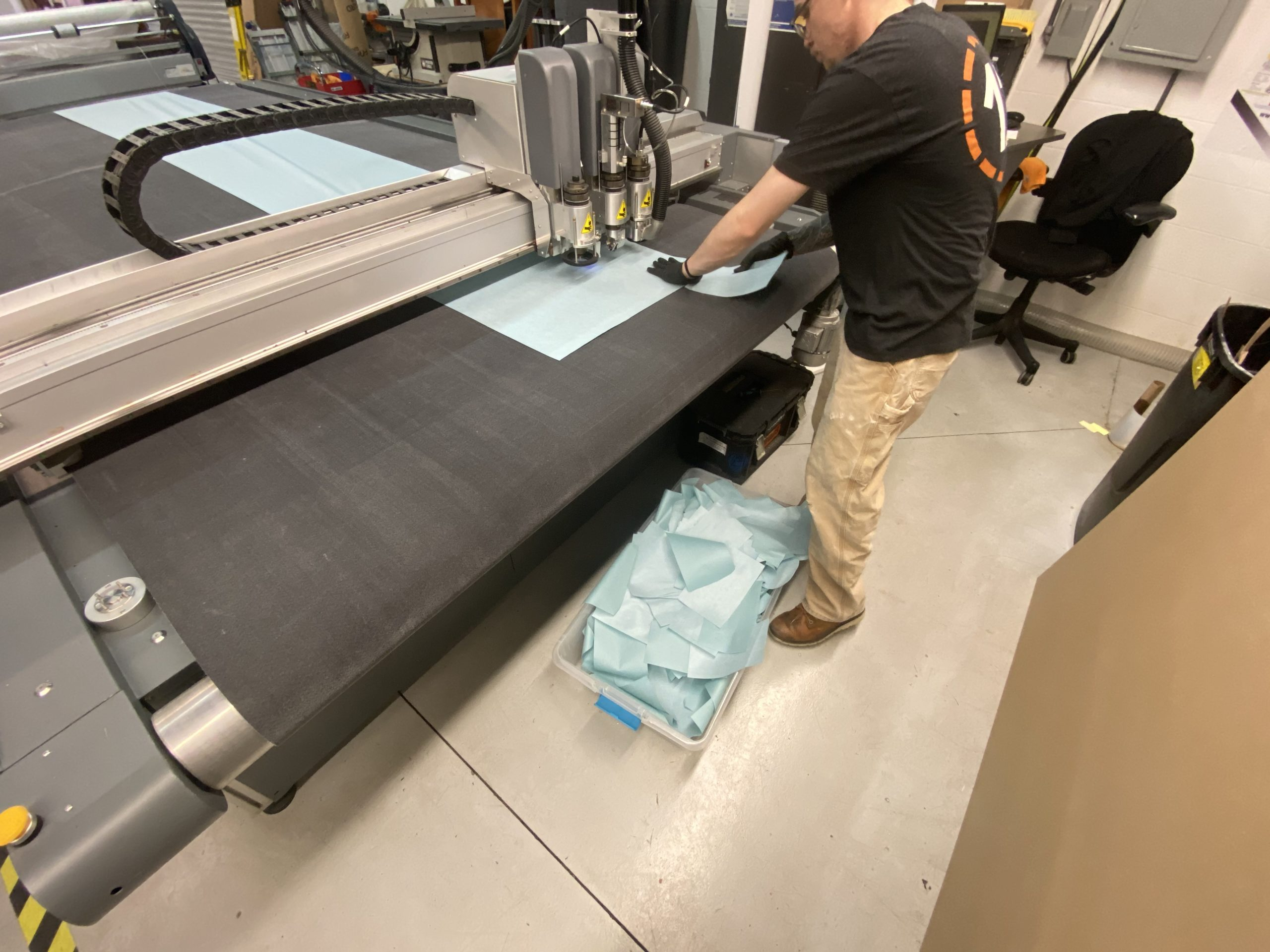 12-Point SignWorks team member working on cutting material