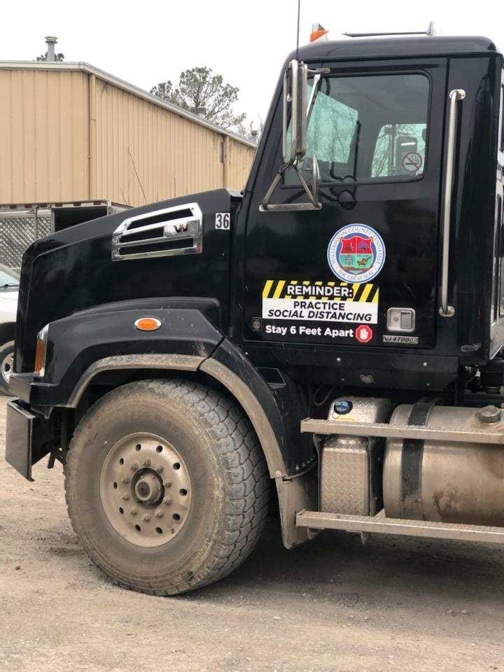 Social distancing truck decal for Williamson County Solid Waste by 12-Point SignWorks