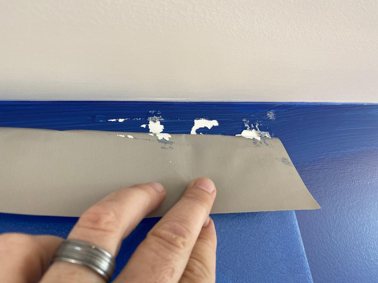 12-Point SignWorks Installer Peeling Paint off walls