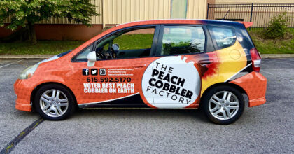 Newest Vehicle Wrap for The Peach Cobbler Factory by 12-Point SignWorks