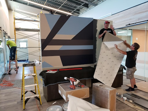 Production Team Installing Graphics for Lamar National Bank in Celina, TX