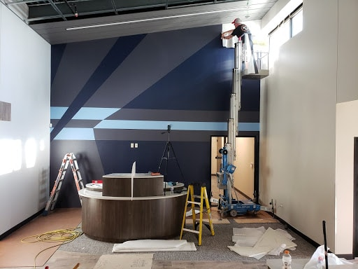 12-Point Member Installing the Wall Graphics for lamar National Bank in Celina, TX