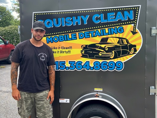 Owner of Squishy Clean Mobile Detailing Standing in Front of New Trailer Decals